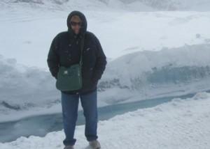 Standing infront of a small crevas of running water from the glacier